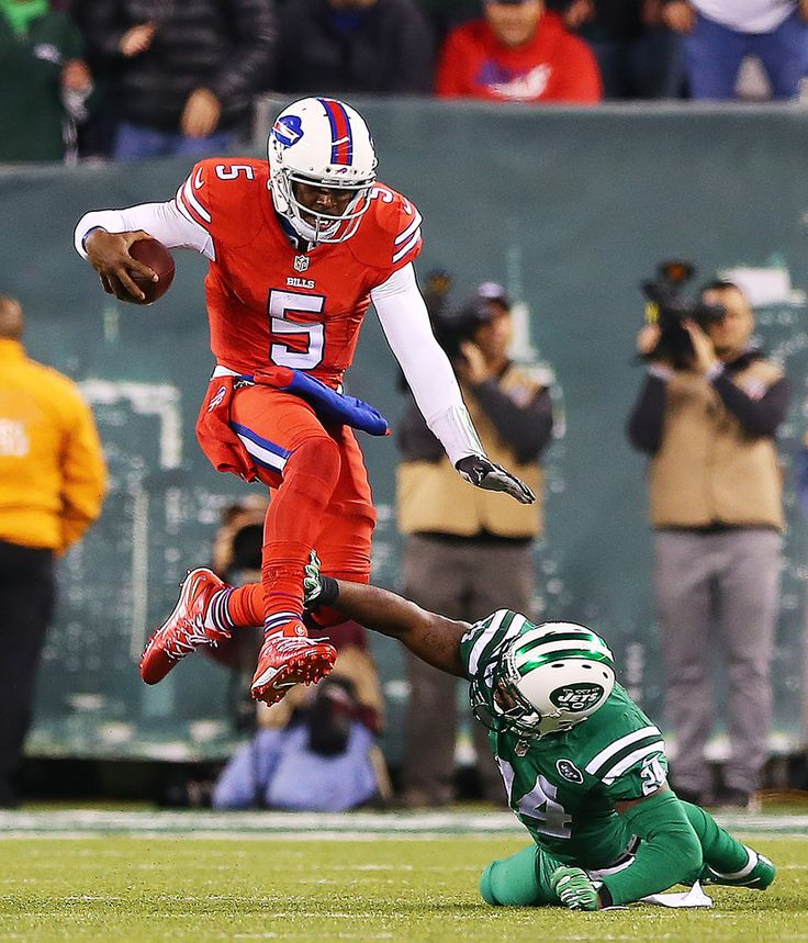 Tyrod Taylor #5 of the Buffalo Bills avoids the tackle attempt from Darrelle Revis #24 of the New York Jets during the fourth quarter at MetLife Stadium on November 12, 2015 in East Rutherford, New Jersey. The Buffalo Bills defeated the New York Jets 22-17. (Nov. 11, 2015 - Source: Elsa/Getty Images North America)