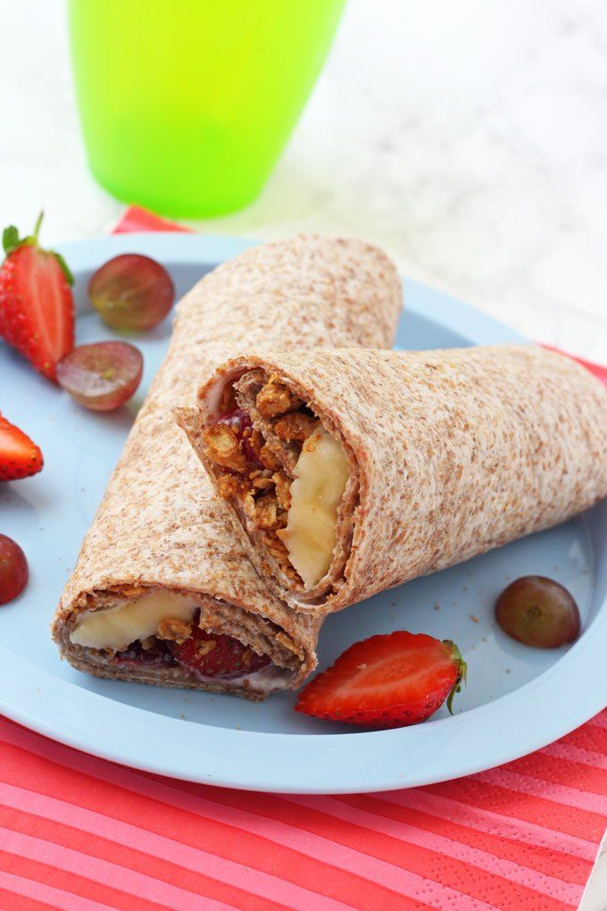 Breakfast Wrap for Kids! Made with a wholemeal wrap, yogurt, chopped fruit and Breakfast by Bella Granola