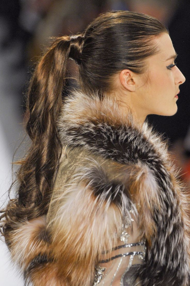 Ponytails: The center-of-the-head ponytails at Dennis Basso were made current with sleek curls and a wraparound base.