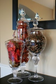 Fall Apothecary Jars-I like the pine cones and autumn leaves.  I would like to have mini pumpkins in the third jar.