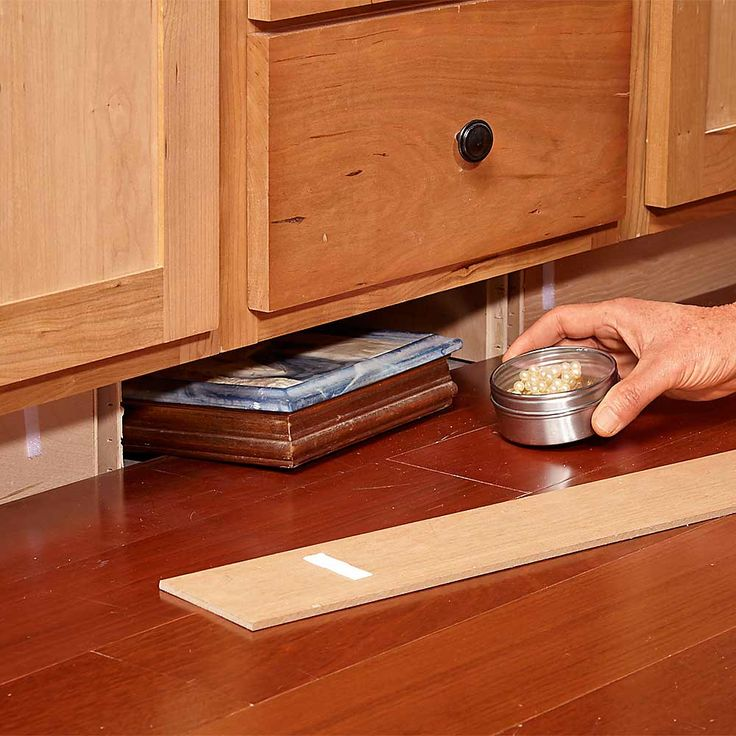 Toe-Kick Hideaway - There's an enormous 4-in.-tall cavity under all those kitchen cabinets behind the toekicks. It takes a few carpentry skills, but you can pull the toe-kicks free and make them removable. Most are 1/4-in. plywood held in place with 1-in. brads, and they're pretty easy to pull off. If you have a secondary 3/4-in. toe-kick, you'll have to cut it out at both ends. An oscillating tool works well for that task.Stick both halves of round hook-and-loop self-adhesive tape to the…