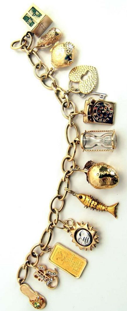 14kt Gold 57.4 grams Charm Bracelet High Fashion with fabulous charms..