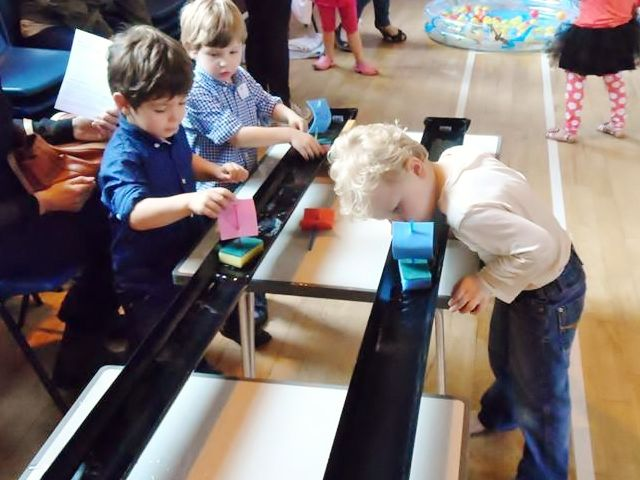 sponge boat racing in gutters - great water play idea (thanks to L19 Messy Church)