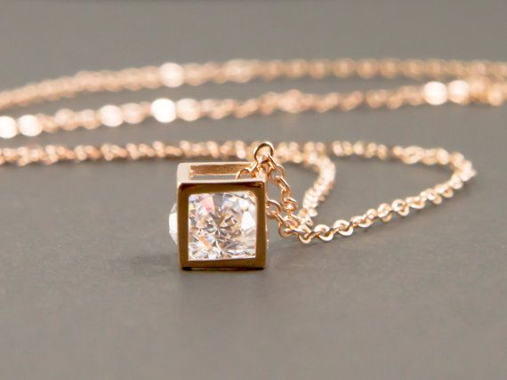 This pretty necklace features a small framed box with a diamond-cut cubic zirconium inside. Box charm: 5mm x 5mm Chain : rose gold plated brass chain  Your jewelry comes in a gift box and ready for your special presentations. PLEASE NOTE - The photo is a representation of what will be custom made for you. Each handmade jewelry will be slightly different.   Shipping Upgrades  Would like to get your orders faster? Please upgrade your shipping below…