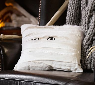 Halloween pillow (pottery barn). Probably wouldn't be too hard to make with strips of white fabric wrapped around a pillow.