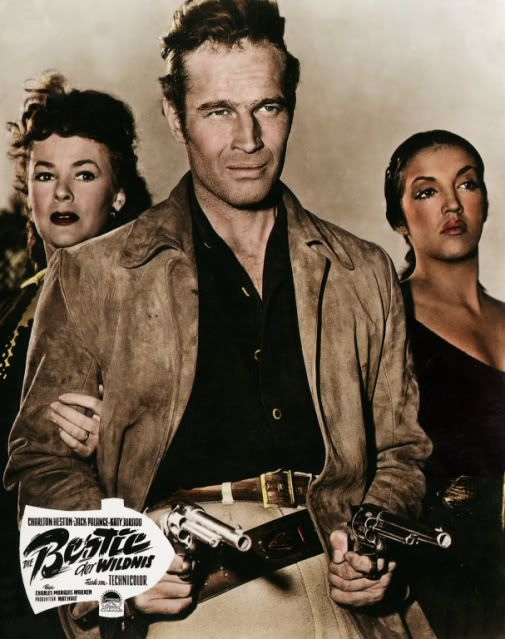 ARROWHEAD (1953) - Filmed near Brackettville, TX - Charlton Heston (pictured) - Jack Palance - Katy Jurado (pictured) - Brian Keith - Mary Sinclair (pictured) - Directed by Charles Marquis Warren - Paramount - Lobby Card.