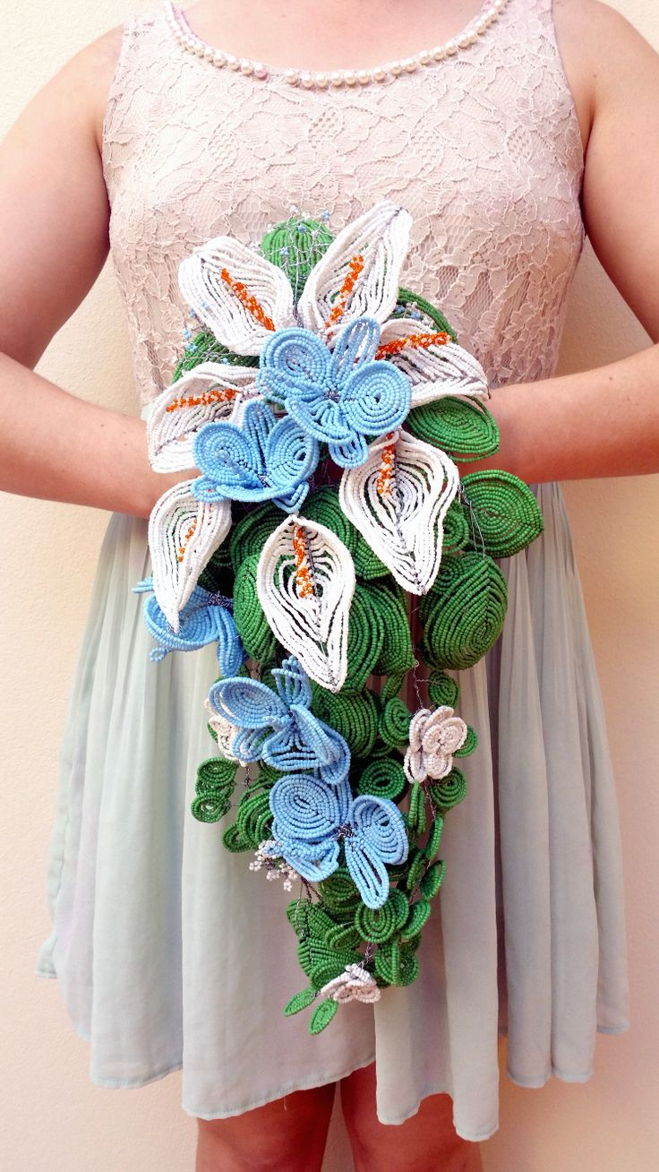 A large bouquet, comprised of french beaded flowers created by Annalee Beer of EverAfter Artisanry.   A lot of work went into this calla lily and orchid cascading bouquet, made of glass and wire for some lucky couple to pass through the generations.