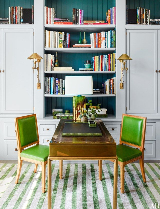 The office includes a vintage brass-and-leather Mastercraft desk and Louis XVI side chairs with leather upholstery   archdigest.com