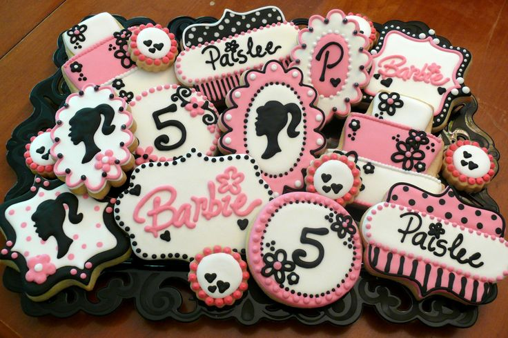 Decorated Barbie cookies for a little girl's 5th birthday party...Barbie silhouette, logo, flowers www.facebook.com/cookiesbycharity