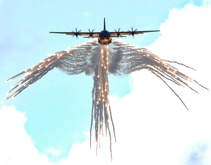 """C-130 """"angel wings"""" flare pattern. Saw this once when I was younger, AMAZING!"""