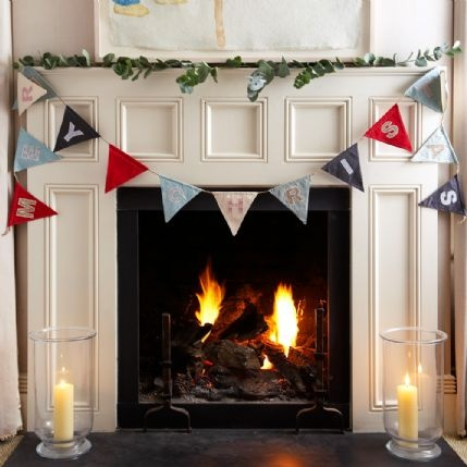 New England-style Merry Christmas bunting can be hung around a fireplace, picture frame or down the staircase to add a festive touch to your home.