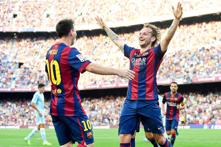 Ivan Rakitic of FC Barcelona celebrates with his teammate Lionel Messi of FC Barcelona after scoring his team's second goal during the La Liga match between FC Barcelona and Granada CF at Camp Nou on September 27, 2014 in Barcelona, Catalonia.