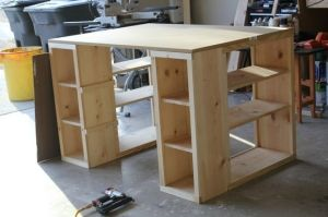 Use short bookcases and plywood top/pre-cut Formica pieces for top, screw together, tons of storage