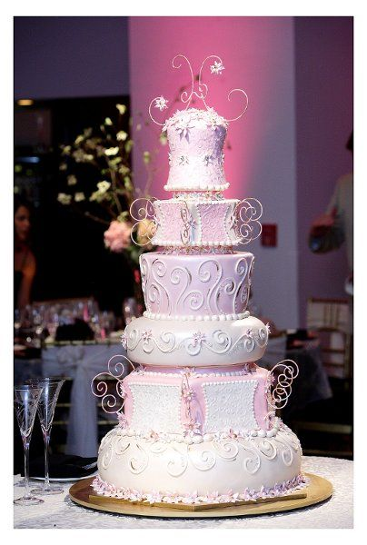 Here is a bridal cake we created for the WE channel. Different shapes add an extra touch of whimsy, don't they?