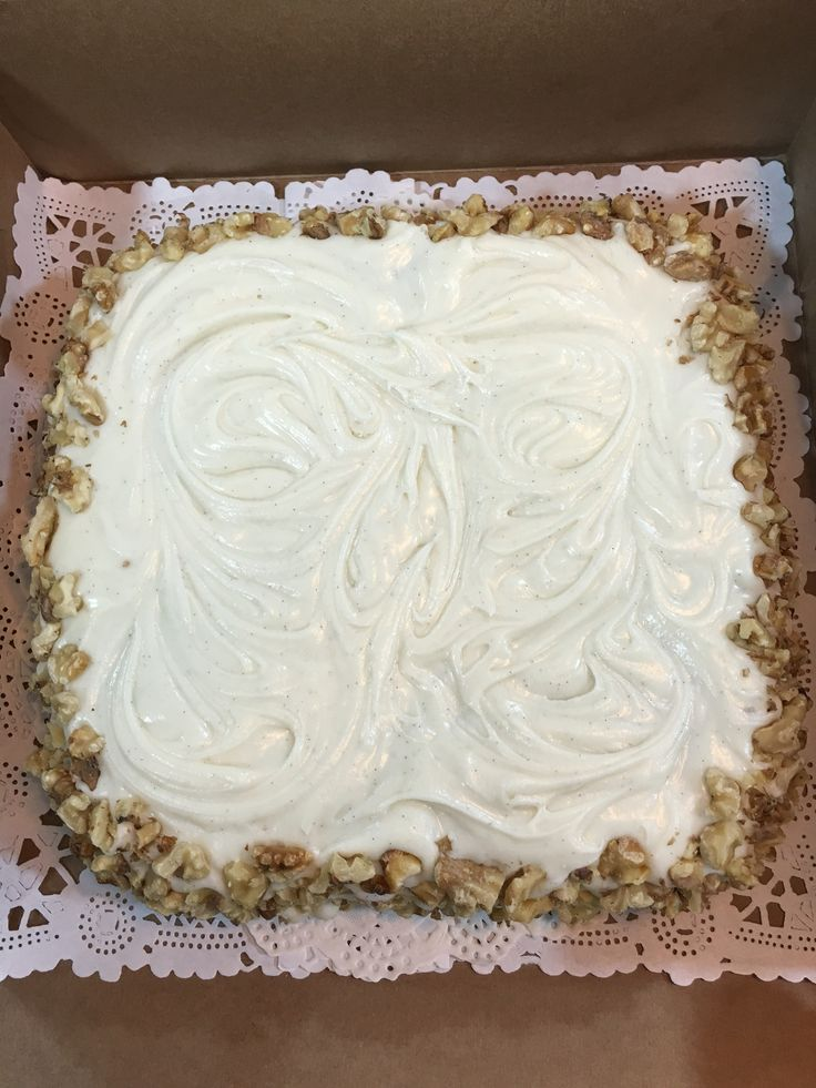 Packed carrot cake , with cheese cream frosting and walnuts