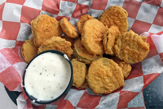 Deep Fried Pickles  Ingredients 24 dill pickle chips, chilled Egg wash, recipe follows Breading, recipe follows Canola oil, for frying Ranch dressing, recipe follows 24 dill pickle spears, chilled