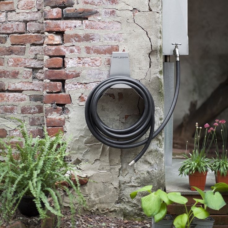 More than just hose reel, Wylie easily hooks onto the back of a wooden plank wall, or mounts into a solid brick or cement wall.