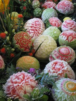 Fruit carving is often used for decorations for weddings, feasts and other celebrations. Various fruit carvings are often combined with natural greens and flowers to make elaborate and colorful displays.