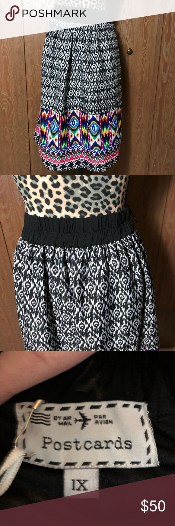 New Postcards Tribal Print Skirt New tribal patterned skirt from Postcards. Size 1x and it is 26 inches long. Has an elastic waist in the back.   💜All sales are going towards college tuition for the spring semester! I am majoring in Elementary Education and I love it! Thanks so much for helping me reach my goal of becoming a Kindergarten teacher!💙 Postcards Skirts