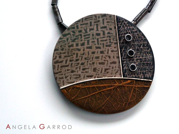 """ Eyes to the Past "" Necklace Close Up...................Polymer Clay, Sterling Silver, Aluminium, rolled and patinated Steel."