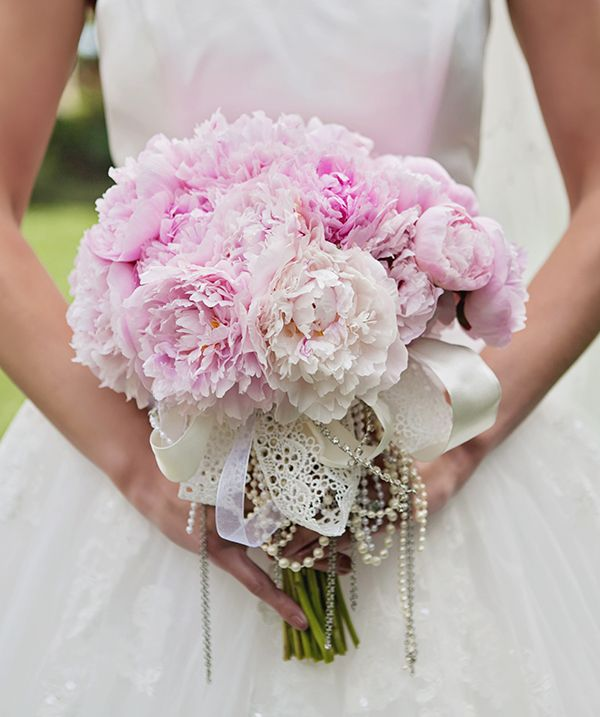 A whimsical bouquet of pink, cream and blush peonies.
