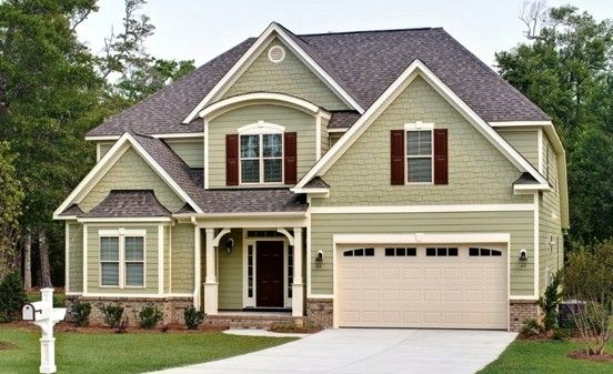 Savvy Homes Trent Americana style home. Beautiful sage green exterior, hardi plank heathered moss siding. #TrentAmericanaHomePlan #SavvyHomes