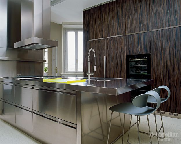 the stainless steel kitchen island and cabinetry are from xera an italian kitchen