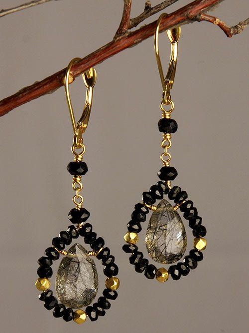 I like the idea of a seed bead frame for a teardrop or briolette bead.