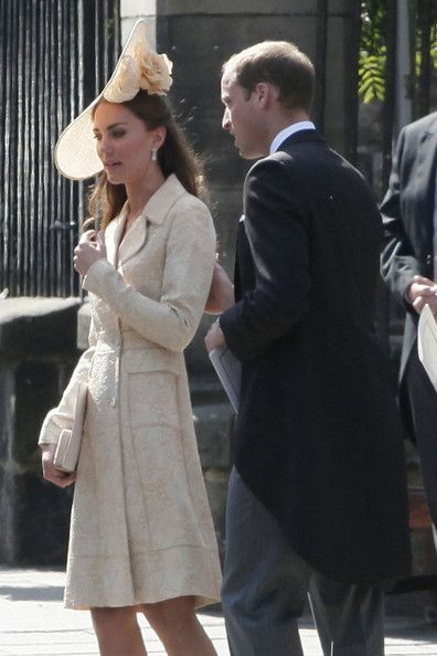 Prince William put his arm around wife Catherine, Duchess of Cambridge, as they attend the wedding of his cousin Zara Phillips to Mike Tindall at the Canongate Kirk on Edinburgh's historic Royal Mile, July 30, 2011.
