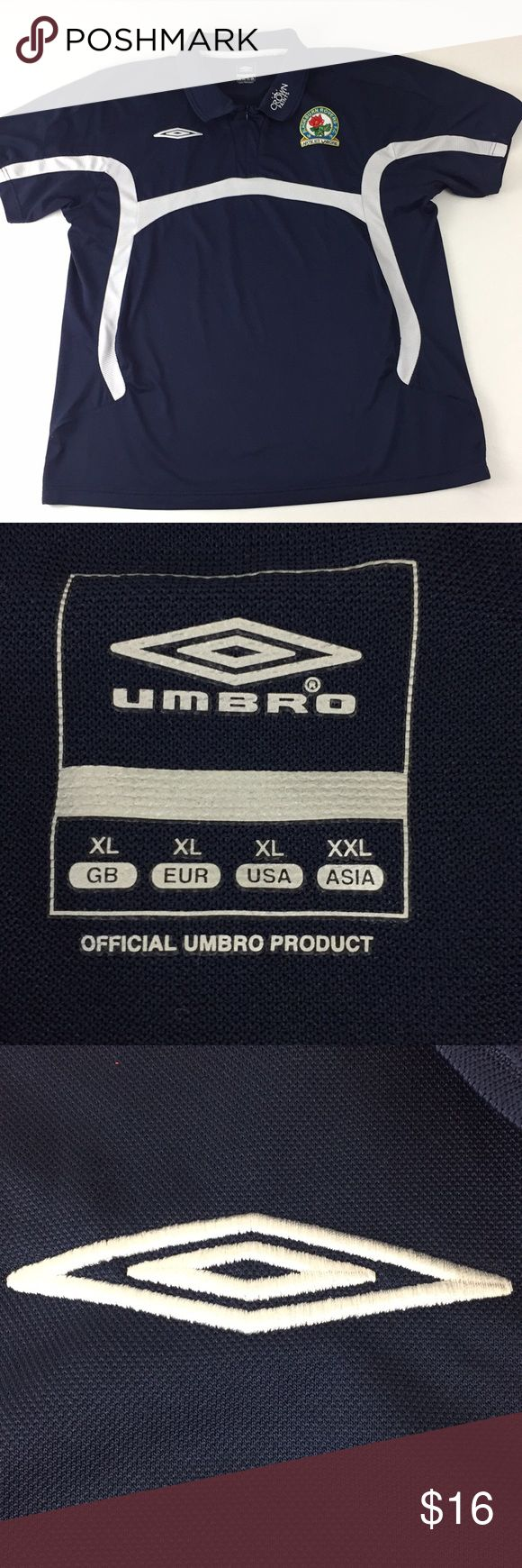 "Umbro Navy Short Sleeve Shirt.  I9 Umbro Navy Short Sleeve zip collared Shirt with white mesh detail.  Men's size XL. Embroidered Umbro logo on chest. Blackburn Rovers F.C. Art et Labore patch on chest. 100% polyester. Measurements are approximate. Chest:  48"", length: 28"". Umbro Shirts Polos"