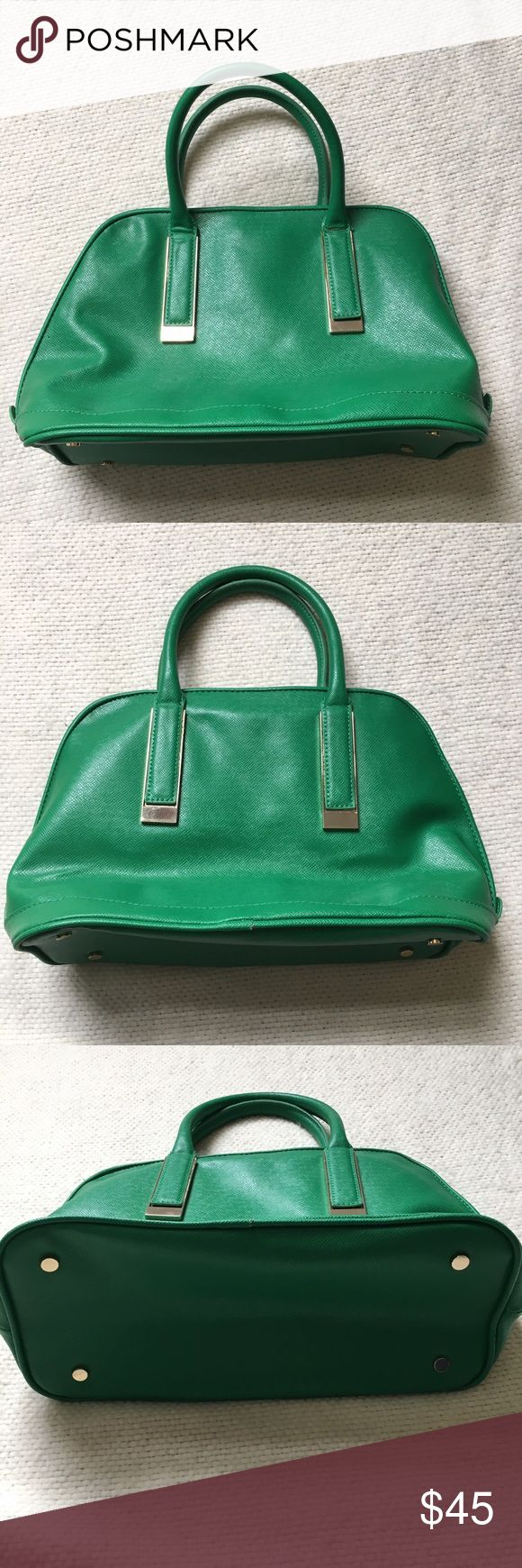 Ivanka Trump Green Dome Bag Ivanka Trump Green Dome Bag. Vibrant green! Excellent condition. The only issue is the stitching on the inside middle pocket seems to be coming undone (see photo). Ivanka Trump Bags Satchels
