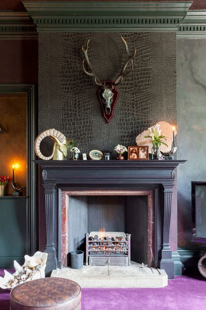 Ellis likes to use small panels of flashy wallpaper in select locations to create a textured feature, and she and Hendrie decided to highlight the fireplace by adding faux crocodile-skin wallpaper to the chimney breast.   Crocodilo vinyl wallpaper: Osborne & Little