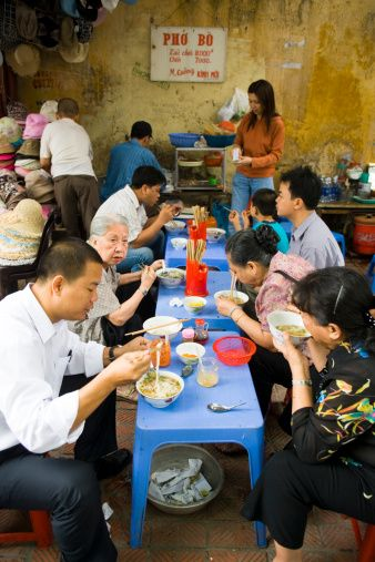 Eating Pho in the streets of Hanoi. Believe it or not, this kind of not-so-fancy place has the best pho you'll ever taste :)
