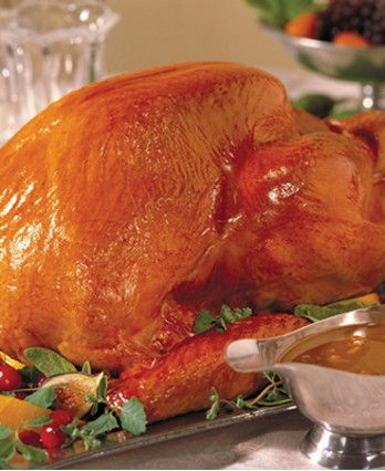 This turkey is glazed with a mixture of apple jelly, apple juice and honey. The herbed stuffing gets its great taste from bits of bacon, dried apples and pecans.