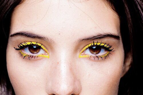 Brighten up your spring makeup routine with bold yellow liner