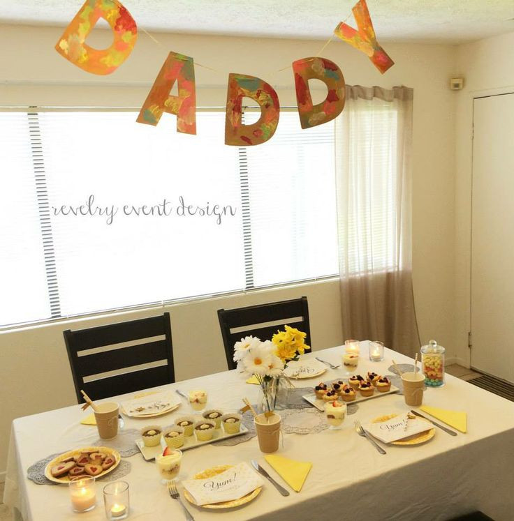 Father's Day breakfast table | yellow and grey theme | rustic | doilies | diy doilies | grey doilies | daddy banner | diy banner | kids crafts | father's day crafts | carrot cupcakes | berry tarts | striped straws | father's day menu | by Revelry Event Design