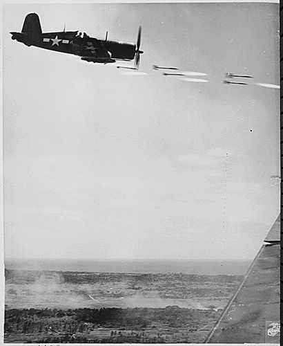 A Corsair unloads its rockets on a Japanese position during the battle for Okinawa, June 1945.