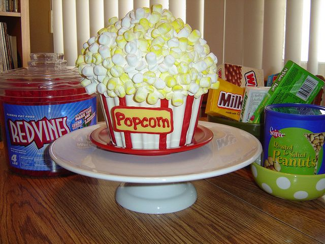 Movie night cake! Great idea for big cupcake cake mold. add marshmallows to the top to make the popcorn!