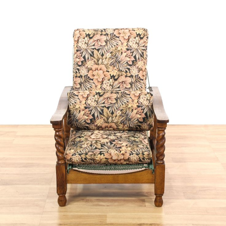 This sleeper chair is featured in a solid wood with a glossy maple finish. This American traditional style recliner has floral upholstery, carved twisting legs, and a mint mesh back. Perfect for relaxing! #americantraditional #chairs #recliner #sandiegovintage #vintagefurniture
