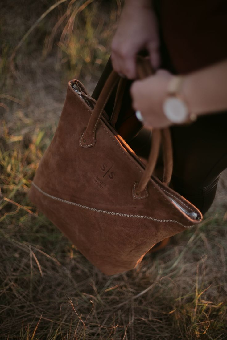 Mary Magdalene hand-stitched leather handbag. She is the sophisticated beauty. Shop online www.swish-swank.com