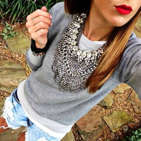 O. M. G.   Silver crystal accent layered statement necklace, grey sweater, white tee, denim shorts.
