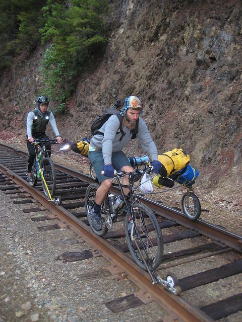 """Rail bikes, loaded by huntercycles. The """"sidecar"""" folds back into a sort of 3rd wheel trailer when off the tracks.:"""
