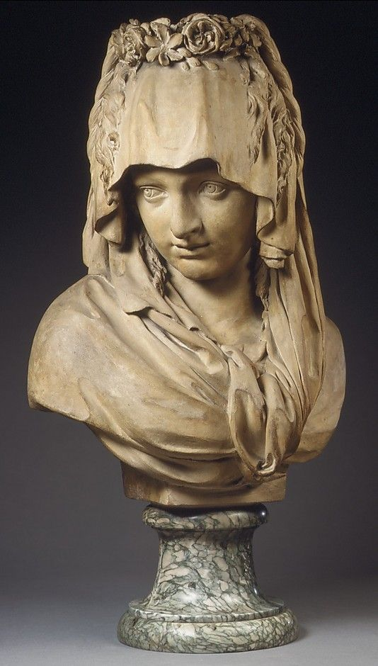 Pierre Julien (1731–1804) | Bust of a Girl Veiled and Crowned with Flowers. Date: ca. 1779. Culture: French. Medium: Terracotta. Dimensions: Overall, without socle: 18 x 12 1/2 x 11 in. (45.7 x 31.8 x 27.9 cm) Socle: 5 x 6 1/2 in. (12.7 x 16.5 cm). Classification: Sculpture.