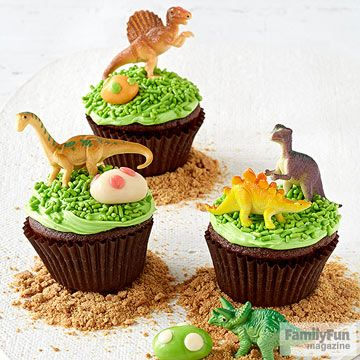 The plastic dinosaurs on these cute cupcakes do double-duty as treat toppers and party favors.
