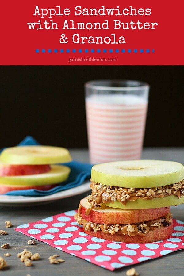Stave off the munchies with these 3-ingredient Apple Sandwiches with Almond Butter and Granola. Great for kids! ~ http://www.garnishwithlemon.com