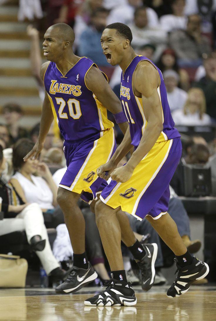 Los Angeles Lakers' Jodie Meeks, left, and Wesley Johnson