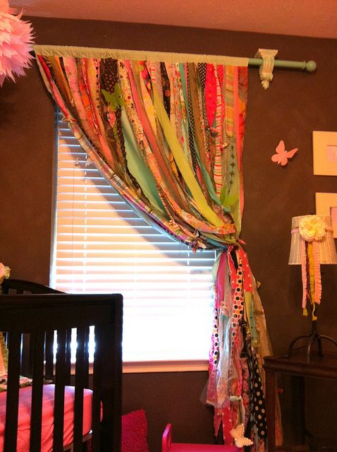 strips of fabric to make a curtain...super cute and colorful...love the color of the curtain rod!!