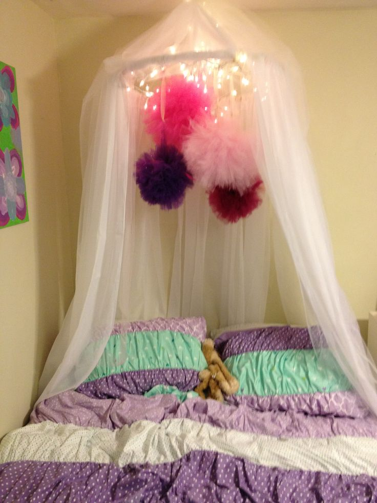 DIY canopy- super easy- hula hoop and cheap curtains with a little tulle! She loves it ! Add poof balls for extra!