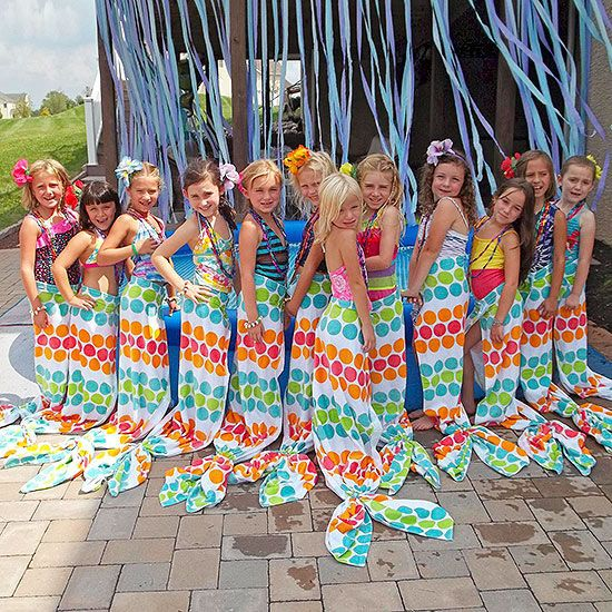 Mermaid tails out of beach towels. Attach Velcro at top for easy closure and release. To make the tail; attach two hair ties to each end.