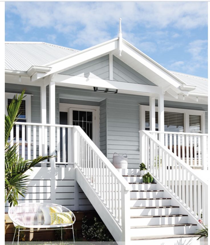 Love the blue grey weatherboard white railings verandah for Beach house gray paint colors
